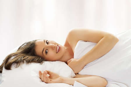 bedding indoors: beauty girl in bed, just wake up Stock Photo