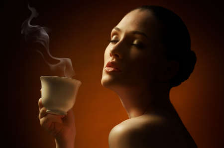 Woman with an aromatic coffee in hands Stock Photo - 7766638