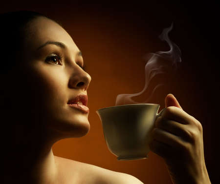 Woman with an aromatic coffee in hands Stock Photo - 7766676