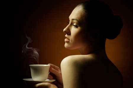 Woman with an aromatic coffee in hands Stock Photo - 7766680