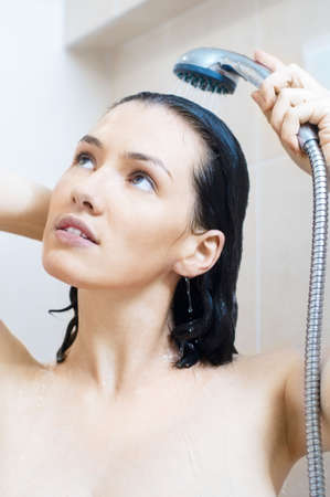 shower head: a beautiful girl standing at the shower