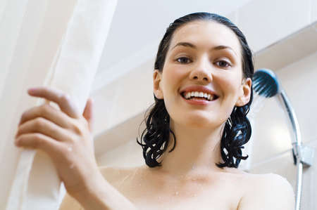 a beautiful girl standing at the shower photo