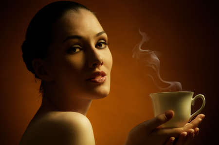 Woman with an aromatic coffee in hands Stock Photo - 7766726