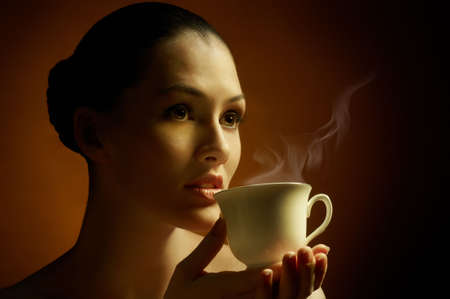 Woman with an aromatic coffee in hands photo
