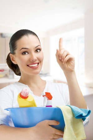Young girl with a pack of detergents Stock Photo - 7766708