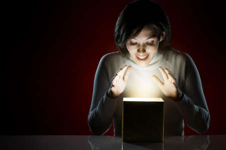 magic box: a beauty young girl with christmas gift Stock Photo