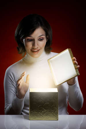 a beauty young girl with christmas gift Stock Photo - 7903995