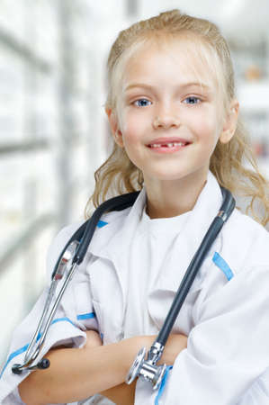 merry children playing as doctor Stock Photo - 8107511