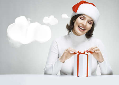 a beauty young girl with christmas gift photo