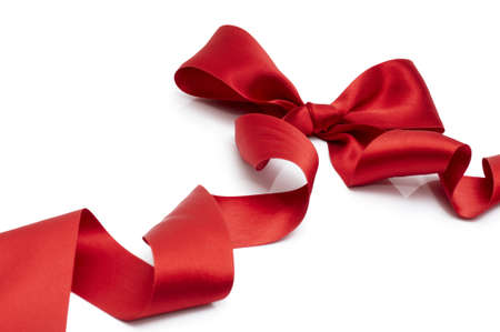 red silk: red silk ribbon on the white background Stock Photo