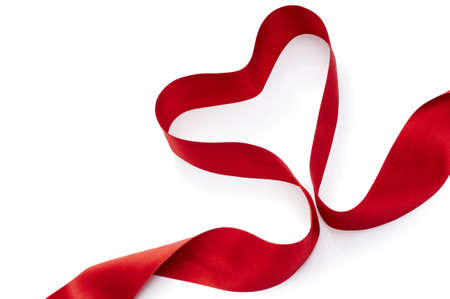 red silk ribbon on the white background photo