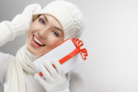 christmas girl: a beauty young girl with christmas gift Stock Photo