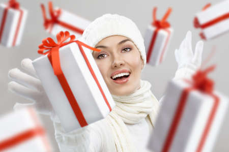 multiple choice: a beauty young girl with christmas gift Stock Photo