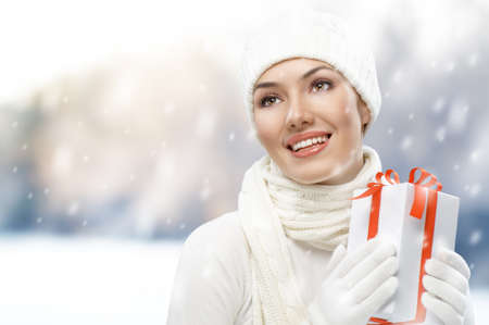 a beauty young girl with christmas gift Stock Photo