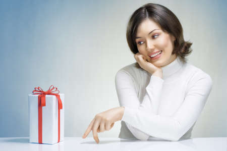 a beauty young girl with christmas gift Stock Photo - 8469904