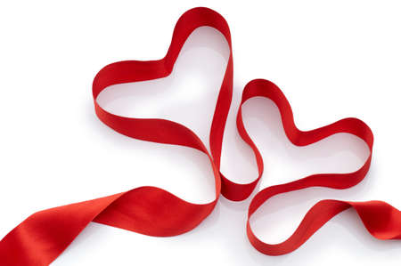 red silk ribbon on the white background Stock Photo
