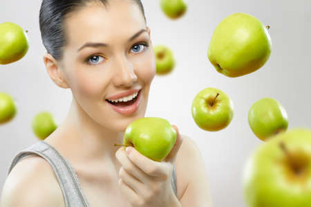 healthy body: A beautiful slender girl eating healthy food Stock Photo