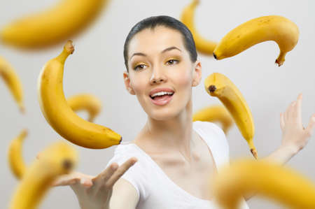 eating banana: a girl with a ripe yellow banana