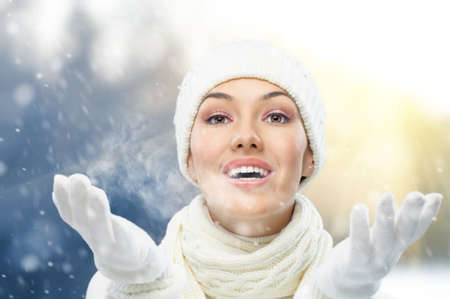 a beauty girl on the winter background photo