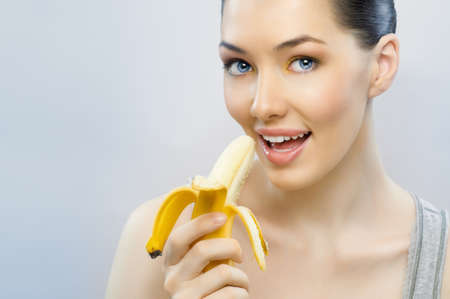 a girl with a ripe yellow banana photo