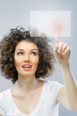 a young beautiful woman making choice photo