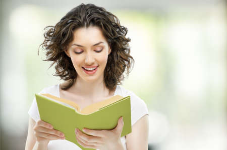 young beautiful girl reading a book Stock Photo - 9362648