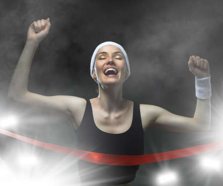 victory: Athlete celebrates victory Stock Photo