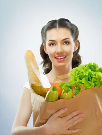 alimentation: girl holding a bag of groceries Stock Photo
