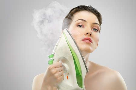 woman ironing: beautiful girl with an iron