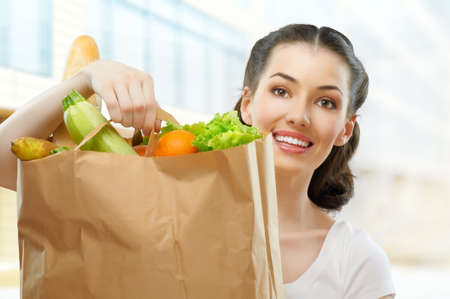 alimentation: girl holding a bag of food