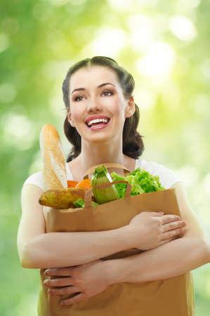 alimentation: girl holding a bag of food