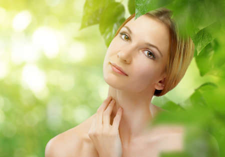 freshness: a beauty girl on the leaves background Stock Photo