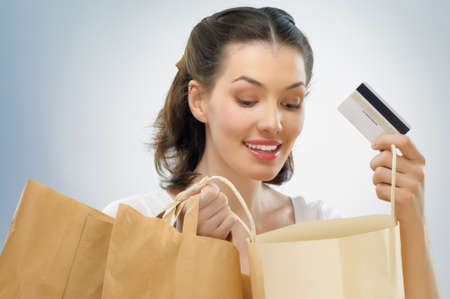 Beautiful woman with shopping bags in hands photo