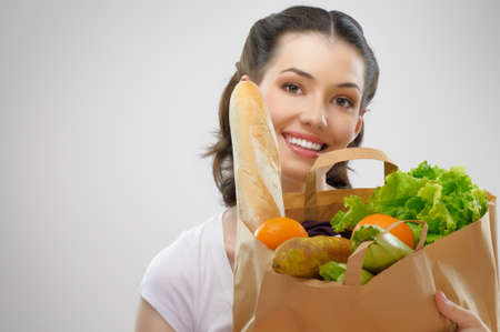 health food store: girl holding a bag of food
