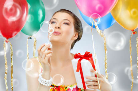 Pretty girl with color balloons photo