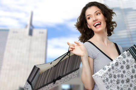 pleasures: Beautiful woman with shopping bags in hands