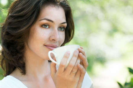 Woman with an aromatic coffee in hand Stock Photo - 9875043