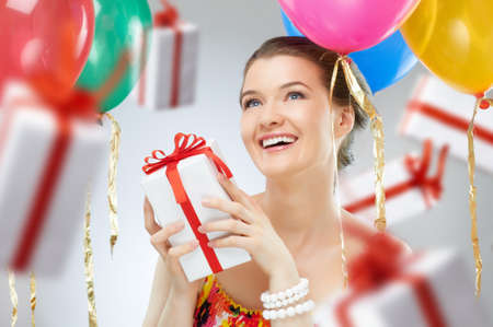 surprise party: Pretty girl with color balloons Stock Photo