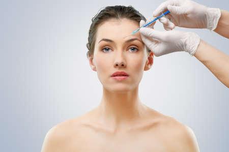 skin treatment: pretty woman getting botox injection