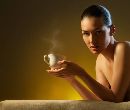 Woman with an aromatic coffee in hands Stock Photo - 10399993