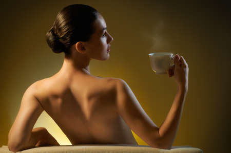 Woman with an aromatic coffee in hands Stock Photo - 10399996