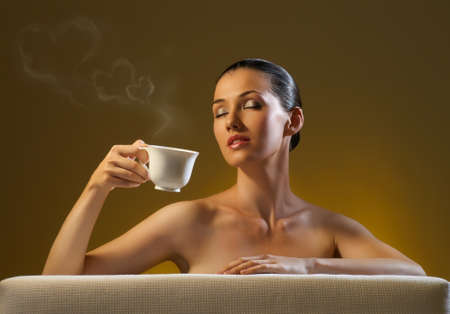 Woman with an aromatic coffee in hand photo