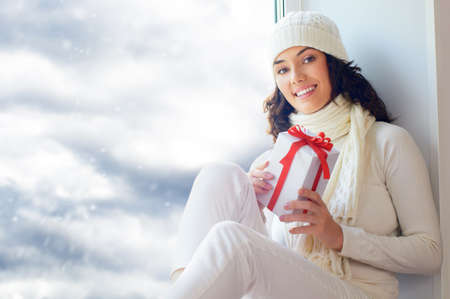 a beauty young girl with christmas gift Stock Photo - 10537077
