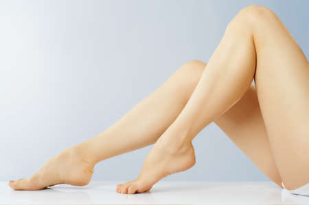 shapely legs: beautiful shapely female legs Stock Photo