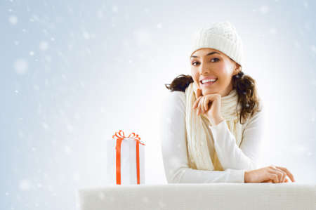 a beauty young girl with christmas gift Stock Photo - 10695082