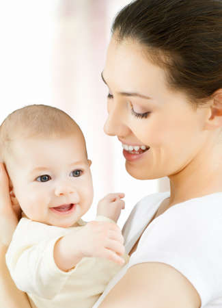 mother and baby: happy mother holding her baby