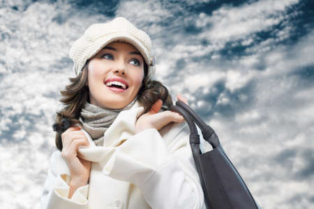 cold weather: a beauty girl on the winter background