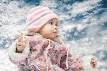 winter storm: baby on the sky background