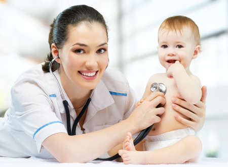 doctor and nurse: a doctor holding a baby on the hands Stock Photo