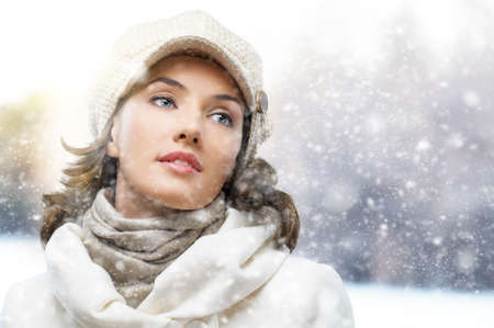 sunny cold days: a beauty girl on the winter background